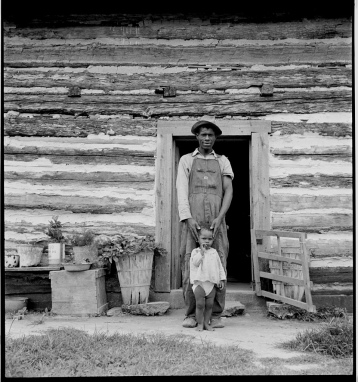 Young sharecropper and his first child. Hillside Farm. Person County, North Carolina