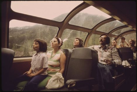 A train car passing through the Cascade Mountains as part of EXPO 1974.  Public Domain Image via NARA.