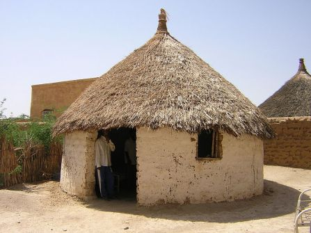 Earthen hut with thatched roof in Toteil, near Kassala, Sudan